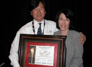 Dr. Kim accepting the sponsor certificate from Ms. Michel Mason, President of BBB North Alabama